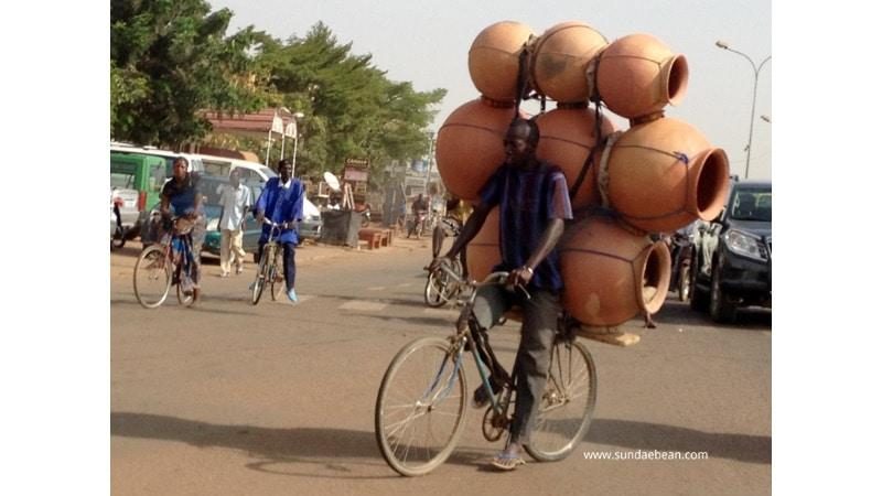A Burkinabé riding through erratic traffic in Ouagadougou, Burkina Faso (West Africa).